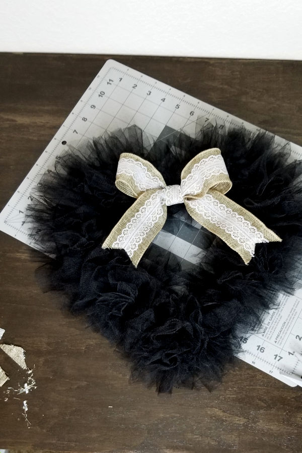*add embellishments - I made a simple bow with the Dollar Tree lacey burlap ribbon and attached it with floral wire.