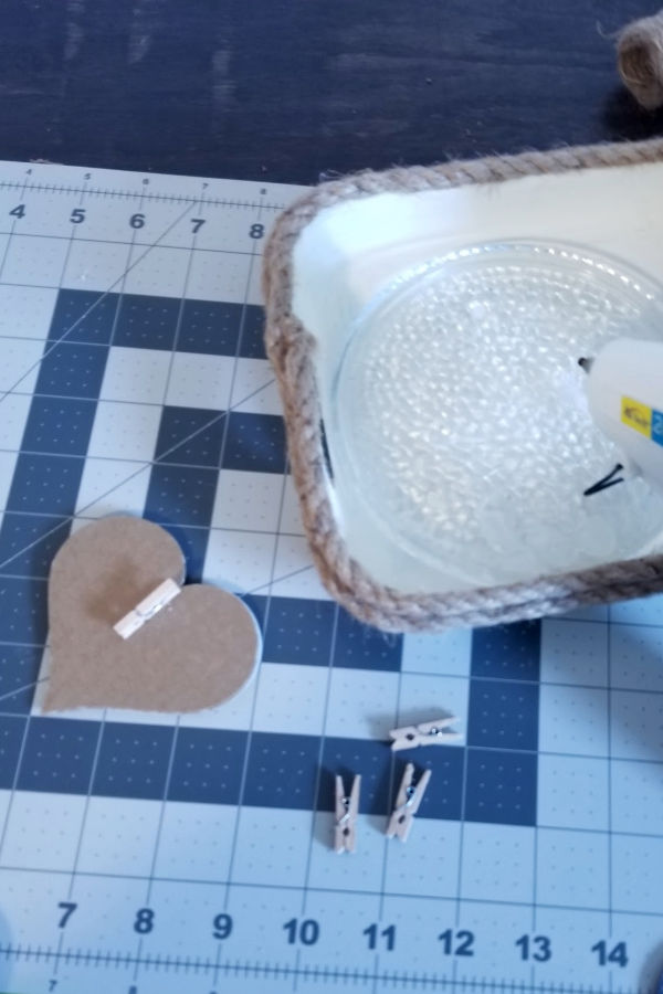 I used hot glue to attach these mini clothespins to the back of each heart - You could just glue the hearts to the twine, but I thought the extra weight would keep the banner from shifting when hung.