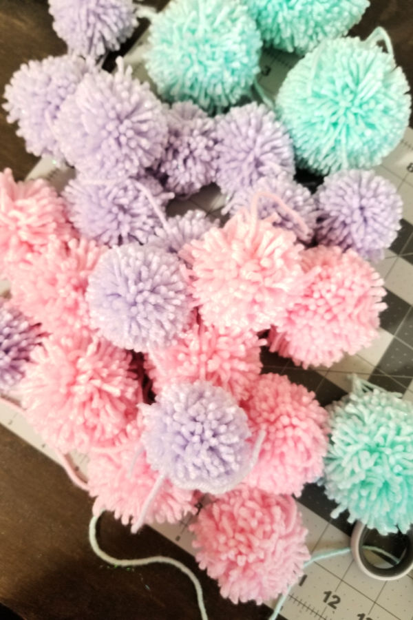 and made just under 60 pom poms! -