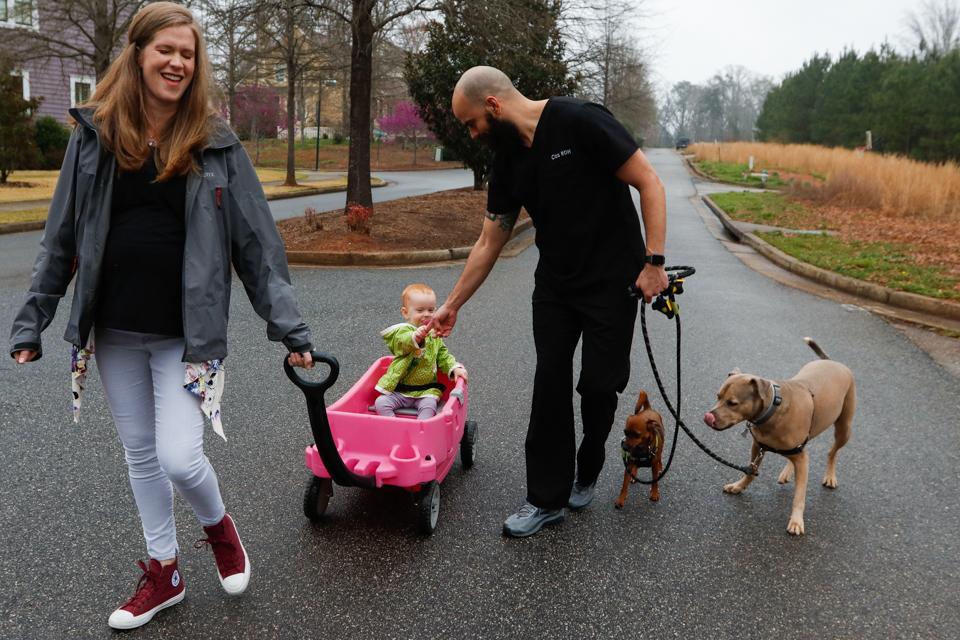 The Zareie family takes an evening walk together through their Athens, Georgia, neighborhood on March 19, 2018.