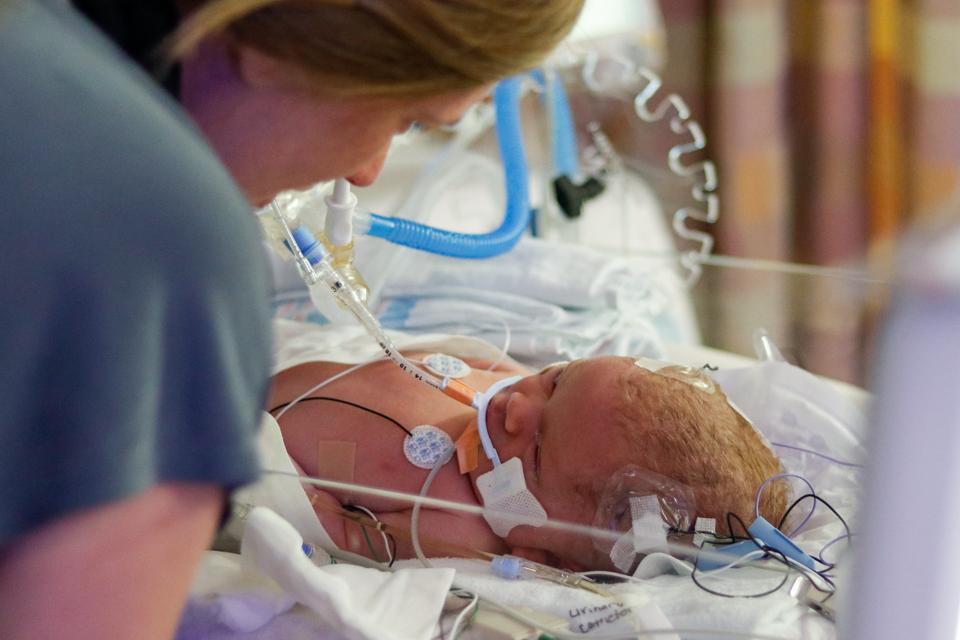Melanie Zareie spends time with her newborn daughter Olivia Moon Zareie at the Gwinnett Medical Center NICU on April 11, 2018.