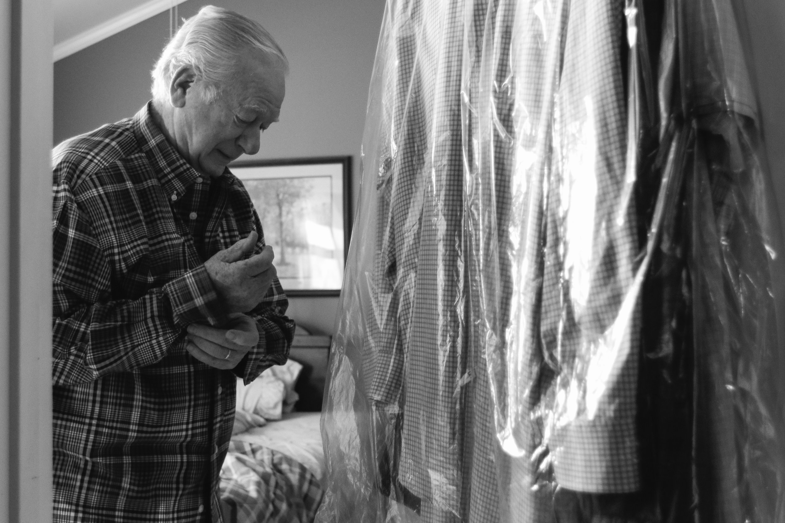 George Cloud gets dressed for the day in Lithia Springs, Georgia, on March 10, 2018. Cloud wears his favorite shirt, the one his wife Esther gifted him for Christmas 2017, one month before her passing.