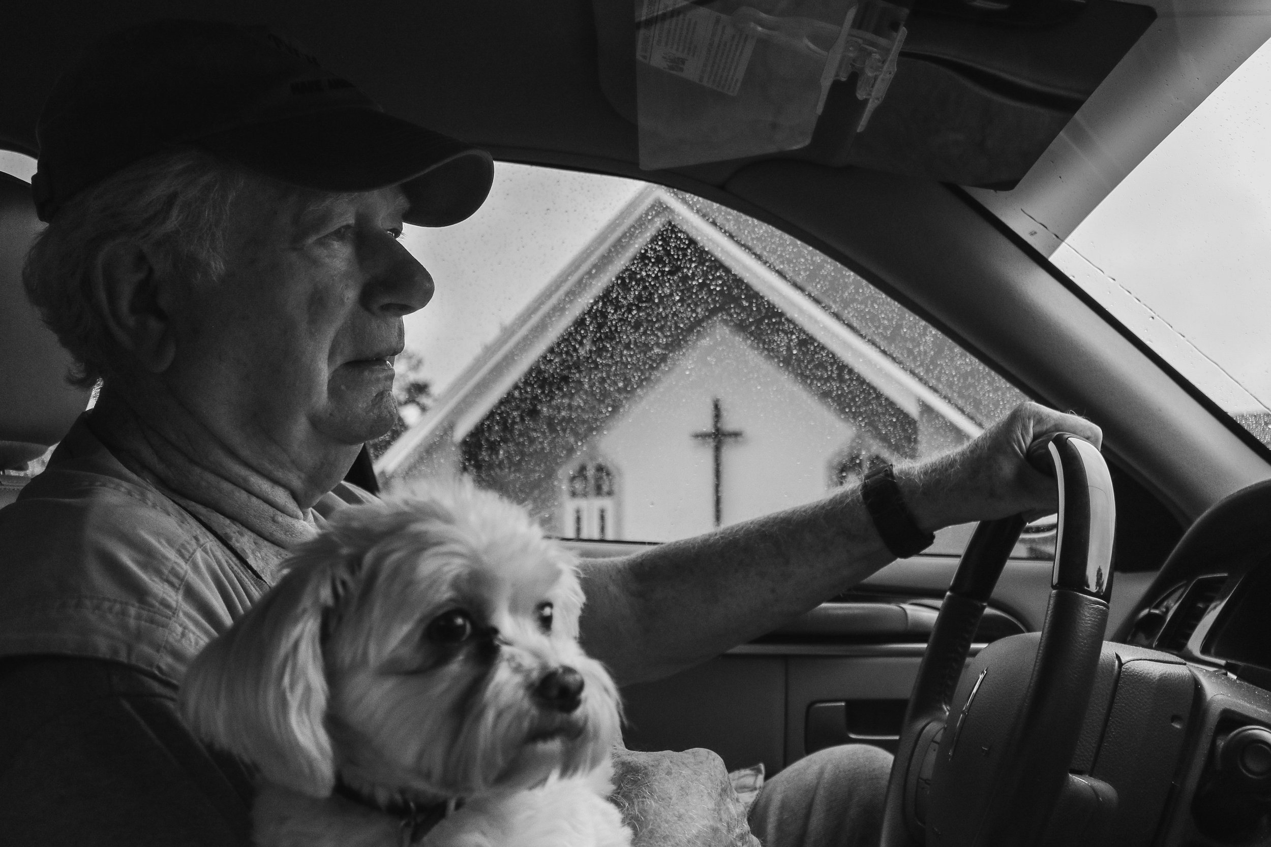George Cloud drives in Lithia Springs, Georgia, with Molly in his lap on Friday, September 28, 2018.