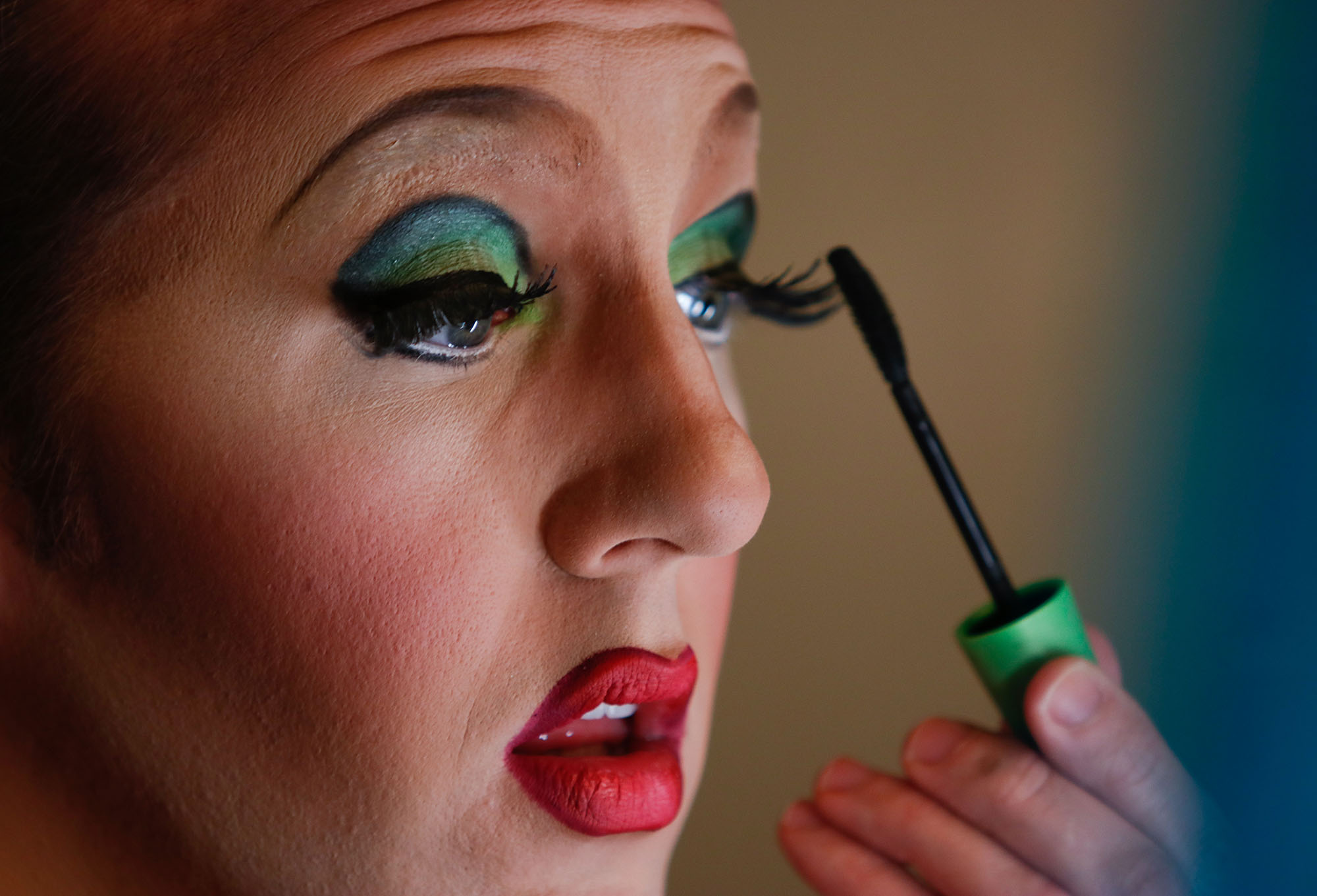 Trevor Ramsey, 29, a University of Georgia graduate student, applies makeup in preparation for a drag performance at Go Bar in Athens, Georgia, on February 21, 2018. Ramsey studies linguistics at UGA and performs as a member of Athens Showgirl Cabaret in his free time.