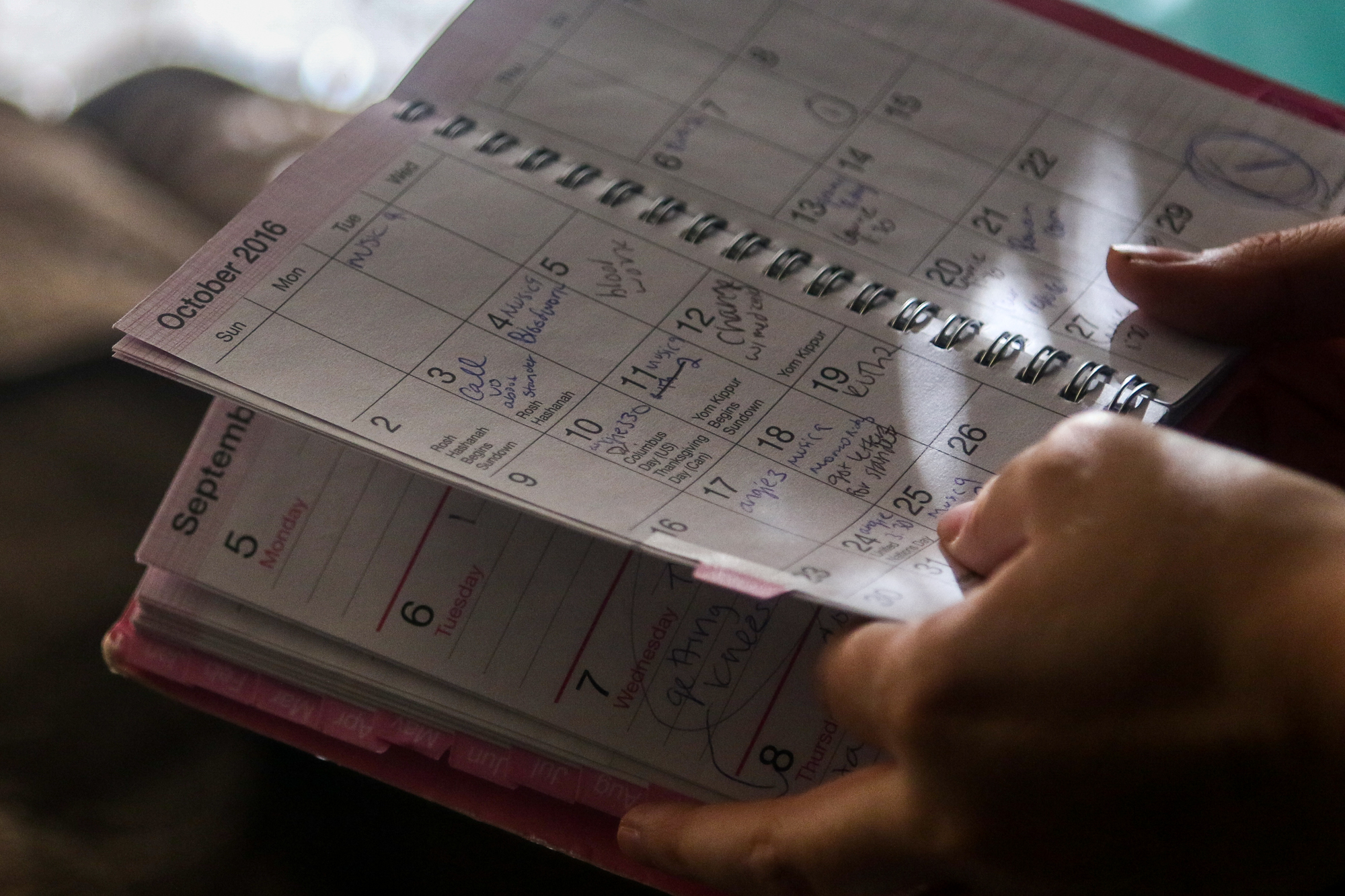 On January 28, 2019, Brittany Cabrera flips through the calendar where she has been chronicling her daughter Penny's seizures since they began in 2016.
