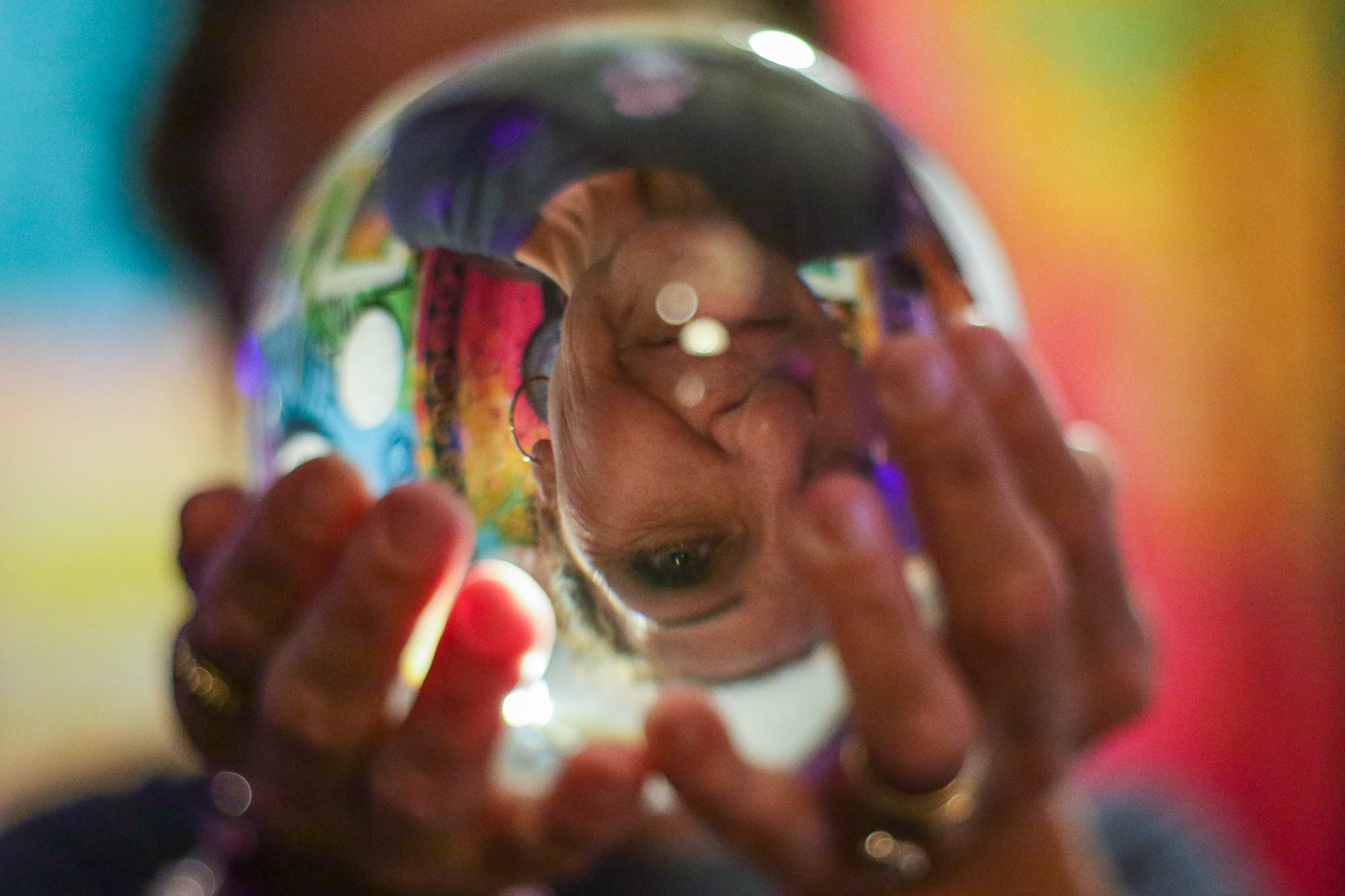 Donna Shook, 54, holds a crystal ball and poses for a portrait at her newly opened spiritual store, Something Magical, in Victoria, Texas, on June 19, 2019.