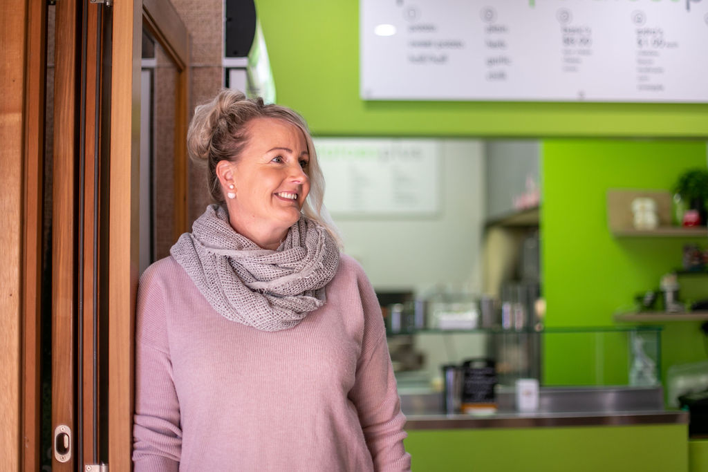 Monica Pedley of Perfect Potatoes Plus stands outside her shop in Launceston's Old Brisbane Arcade. Image by Melanie de Ruyter 2019.