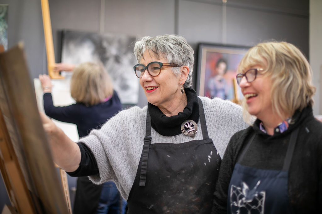 Leonie Duff passes on her skills and knowledge to a student in her studio, Leonie Duff Art Galleries. Image by Melanie de Ruyter 2019.