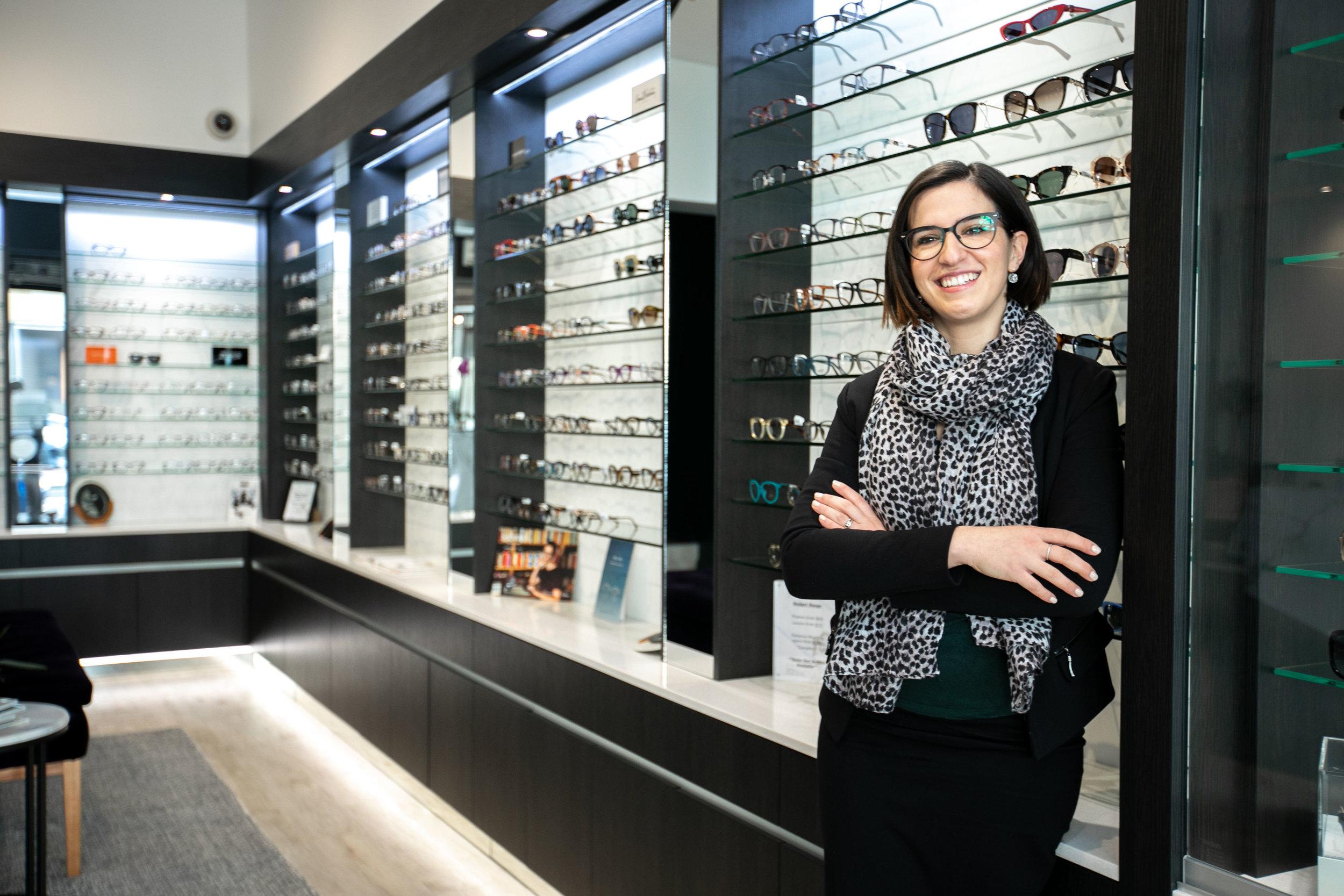 Angela Slama, part owner of  Reflekt  stands in her shop. Image: Melanie de Ruyter for Winterlicous 2019.