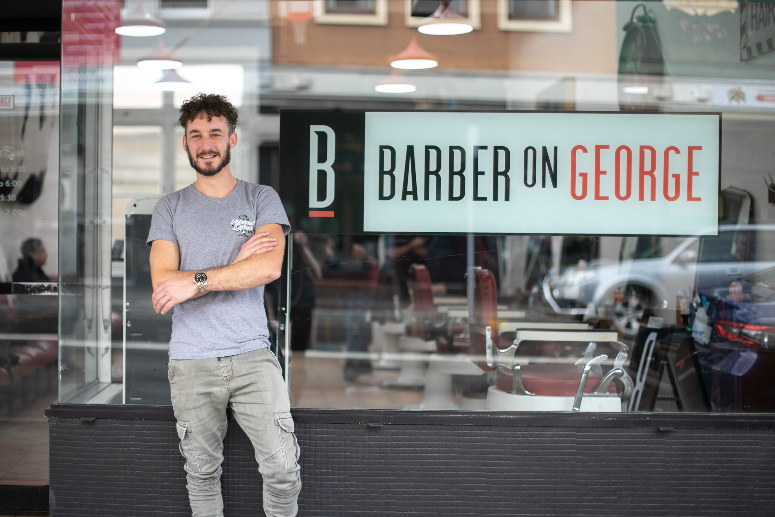 Hamish Mackean, owner and barber at  Barber on George  stands outside his George St barber. Image: Melanie de Ruyter for Winterlicous 2019.