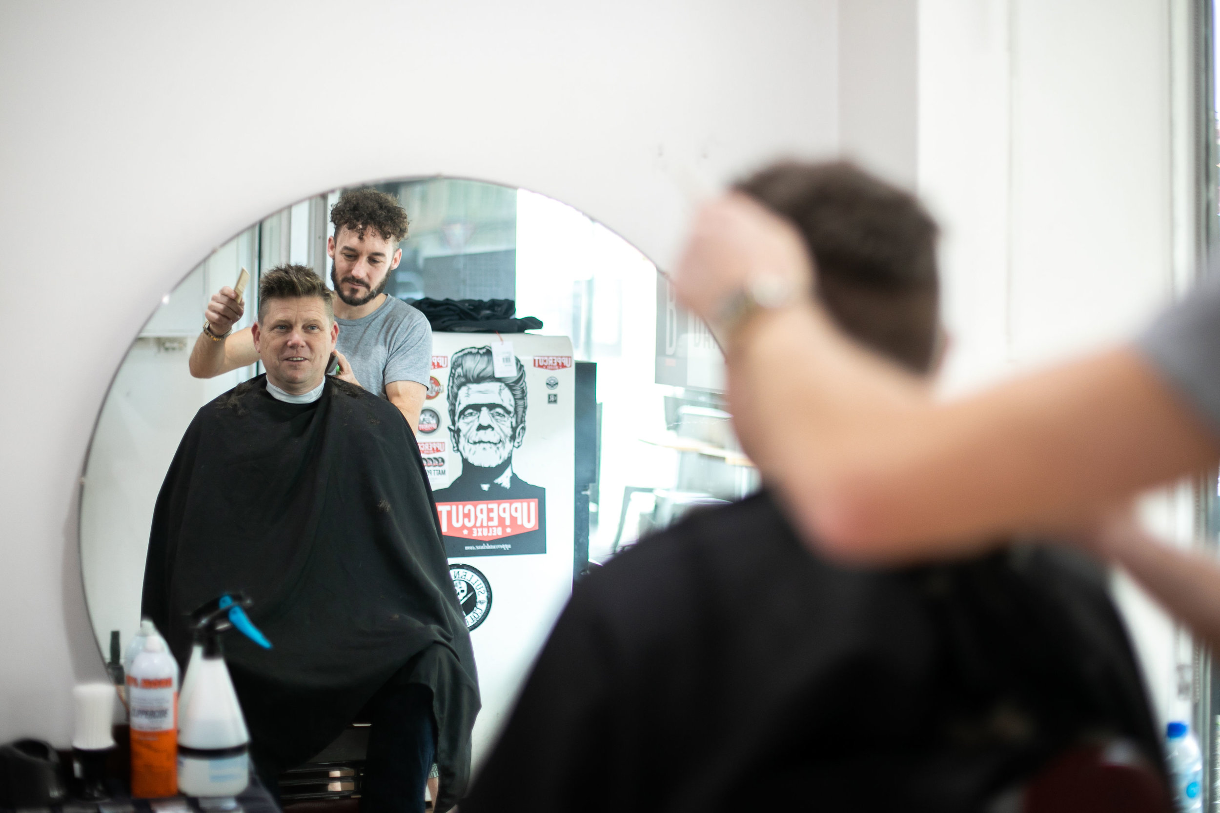 Hamish doing what he does best, mens haircuts. Image: Melanie de Ruyter for Winterlicous 2019.