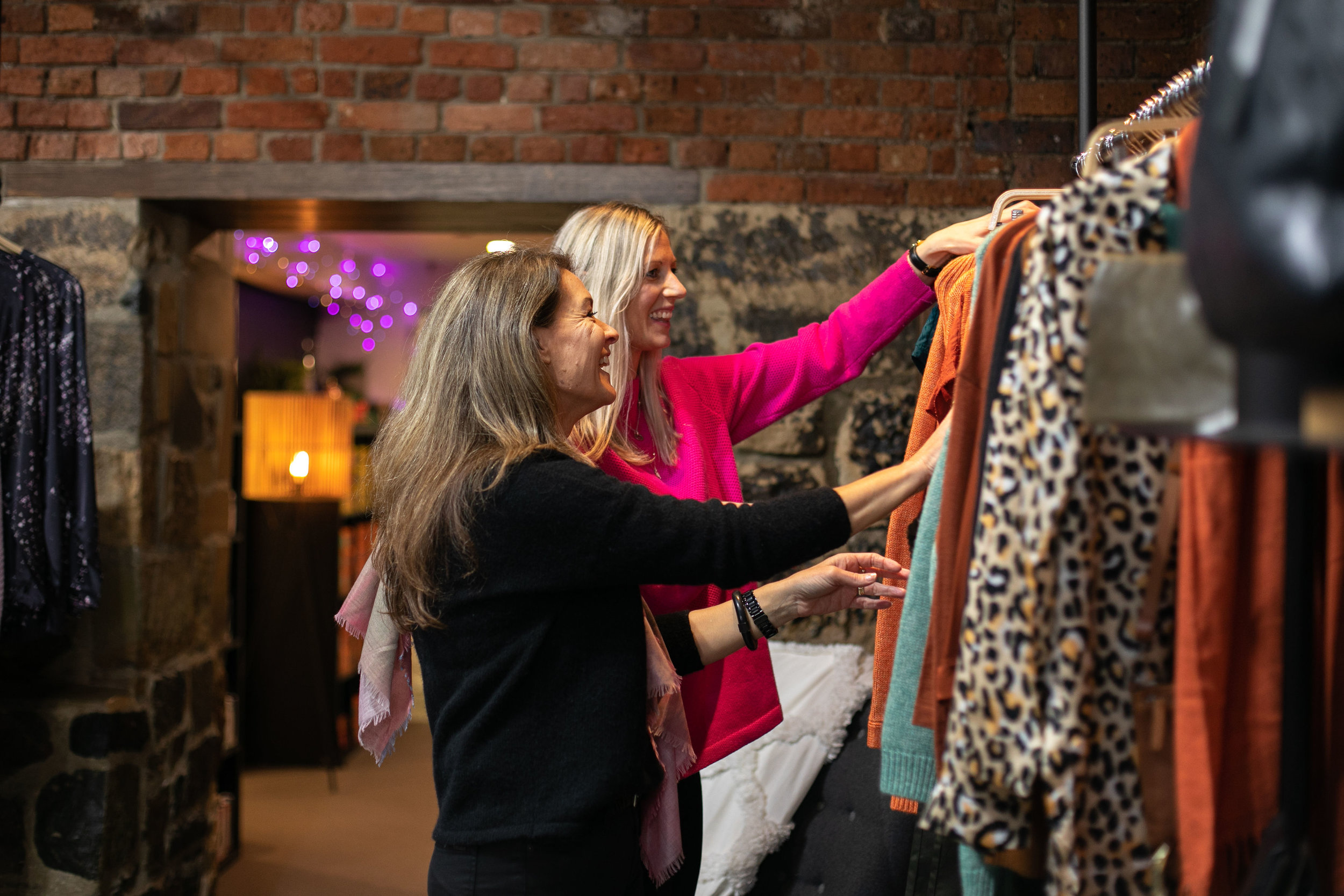 Amanda looks through new clothing stock at Inside Home and Gifts with a staff member. Image: Melanie de Ruyter for Winterlicous 2019.