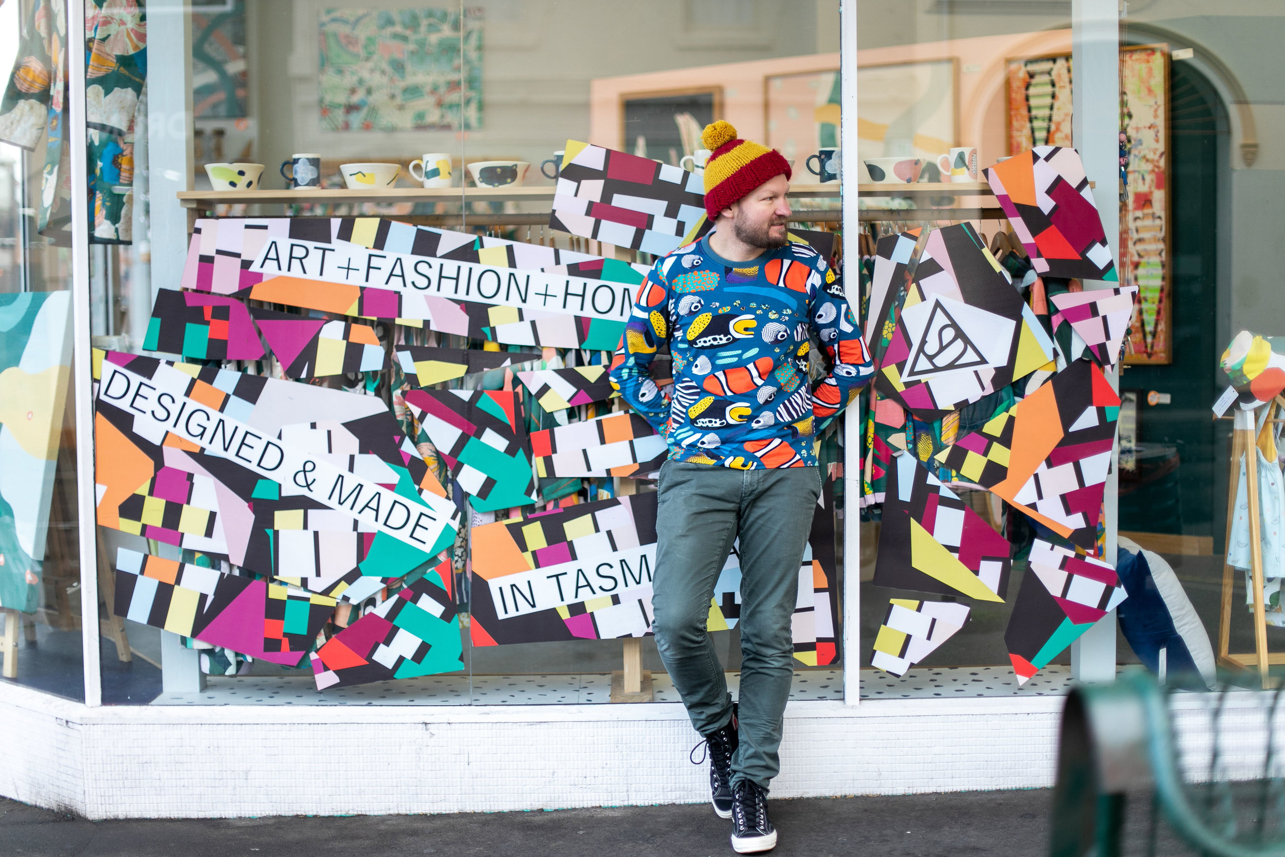 Jamie McCabe stands outside his shop, which is just as colourful on the outside as it is inside. Image: Melanie de Ruyter for Winterlicous 2019.