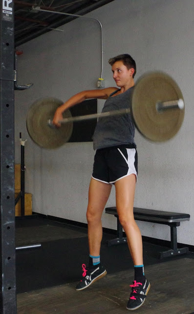 Nothing to see here. Mid-distance runner doing snatch high pulls. Move along if this frightens you.