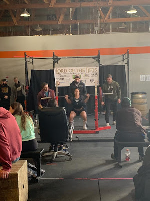 Emily gets after it during the squat competition on day 2.