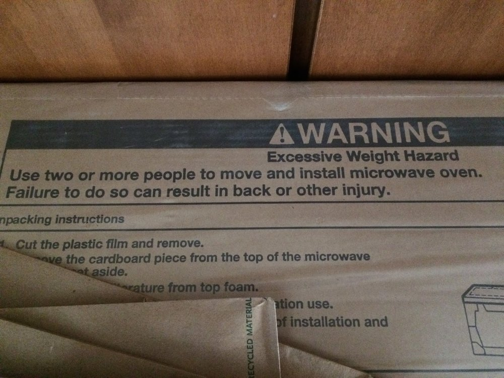 I bought a new over-the-range microwave this weekend. After I carried up the stairs and through the front door I noticed the warning. What has happened to society that a 50 lb (if that!) microwave is considered an excessive weight hazard! (For the record, Amy had no trouble holding it overhead.)
