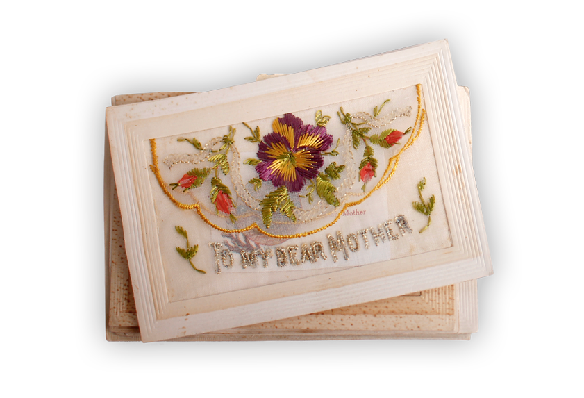 Image of a stack of embroidered silk postcards with sentimental designs.