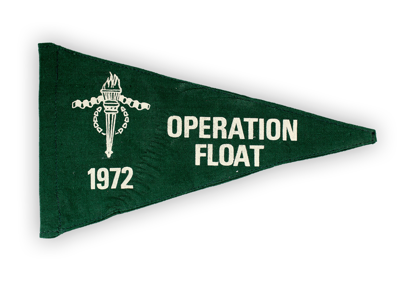 "Image of a green cloth flag showing the words ""Operation Float Nineteen Seventy Two"""