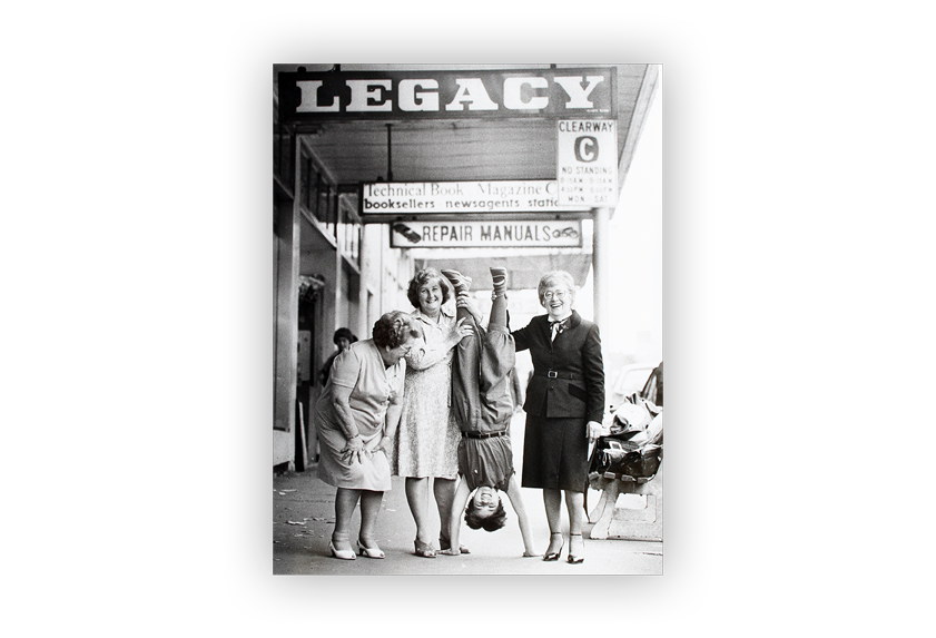 Image of Legacy Widows and child outside Legacy's headquarters on Swanston Street in Melbourne.