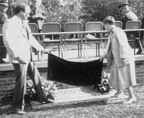 Mr. Robert C. Bell('64), President of The L.W.M.A. Alumni Association, and Mrs. Ellen Turner, Gen. Futch's daughter, unveil the marker for the Brig. Gen. T. L. Futch Parade Field.
