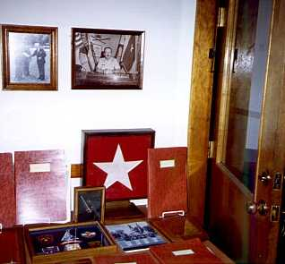 General Futch's picture, flag and papers(to the right). General Futch's silver rank star and cross cannons are in the frame to the lower left. (Photo taken in the museum - May 2, 1998.)