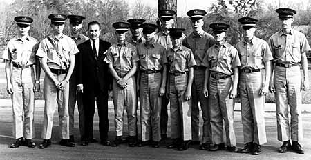 - Governor's Day - LWMA Campus - 1965   (left to right) Paul Woodard ('67), Samuel Chambers('65), Steve Huchko ('68), Gov. George C. Wallace, Thomas Bridges ('66), Mark Estopinal ('69), Rolf Sasser, Louie Hayes, Jr. ('67), Charles Rickey, Omar Nagle, III ('66), Walter Hobson, Frank Richmond ('65), Wesley Bain ('67)   Photograph contributed by   Samuel Chambers ('65)