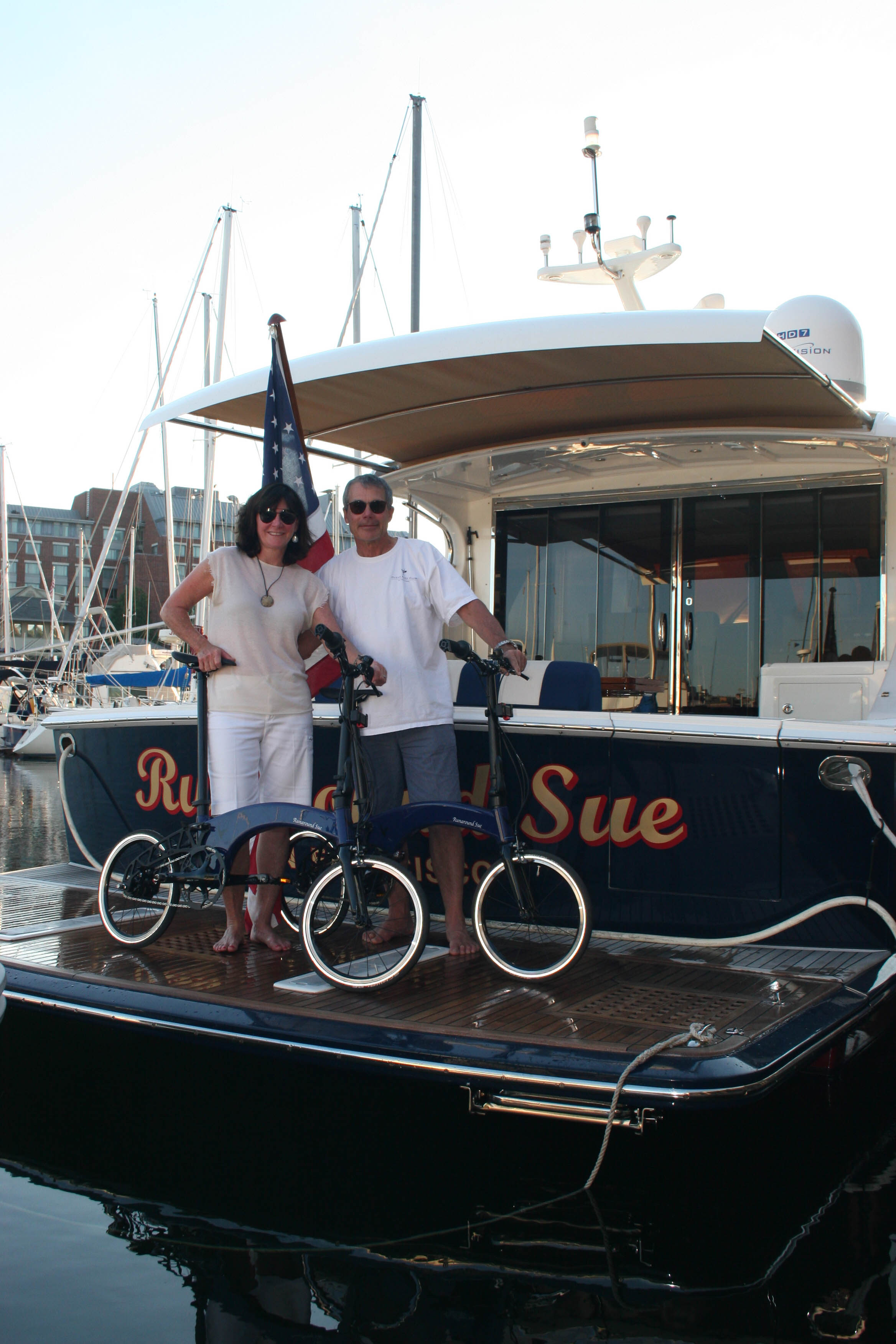 Happy bespoke Hummingbird owners and their boat.