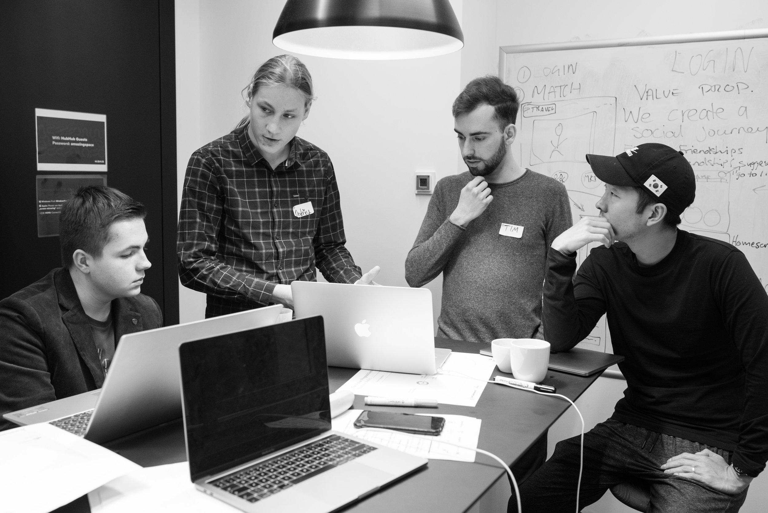 Photo of focused team members taken during Startup Weekend in Prague by Tatiana Shalunova.jpg