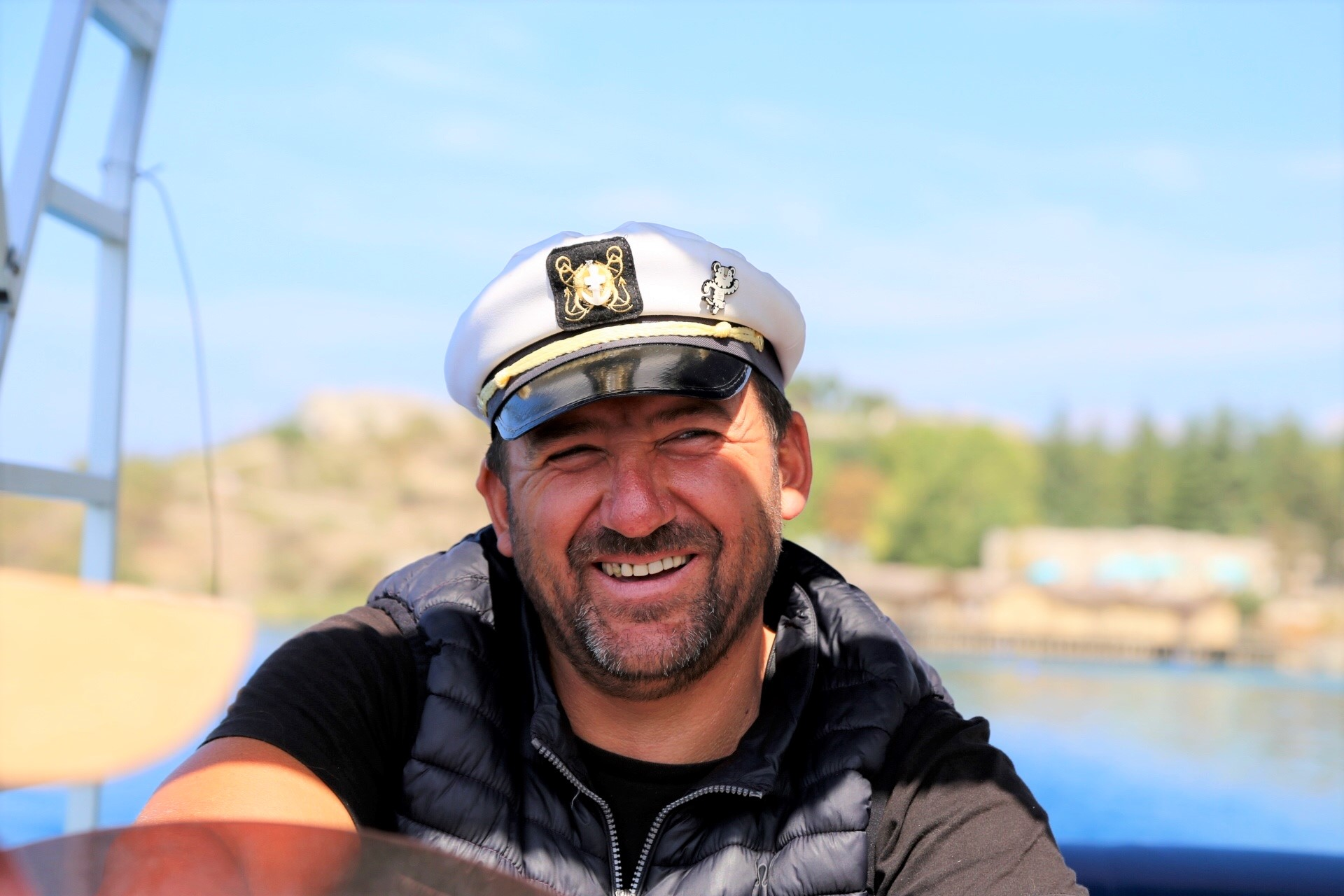 The smiling faces of Macedonia, our boat captain.