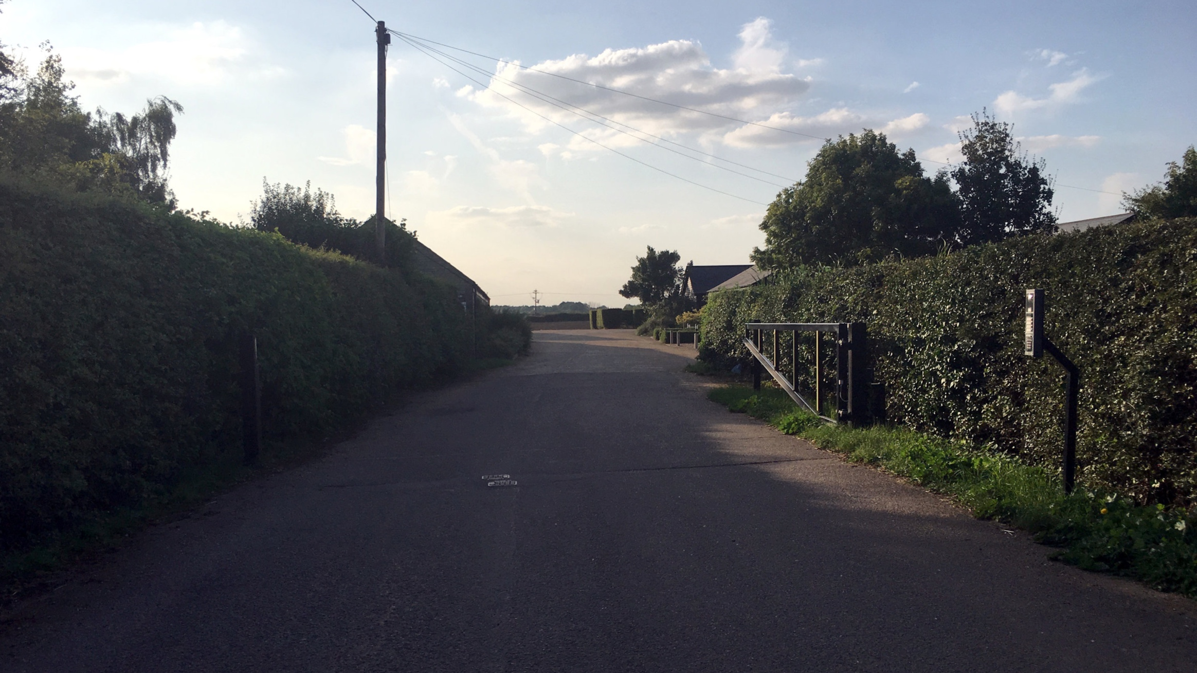 Turn right after the hedge/before the first building