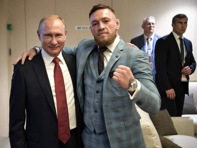 "Former UFC champion  Conor McGregor  seems to be having fun in Russia.  One minute he's checking on the progress of his ""Russian compound"" in an intentionally vague video  posted to Twitter . The next he's checking out the World Cup final as a ""guest"" of Russian president Vladimir Putin.  Wait, what?  Yeah, that's right. That's the biggest star in MMA doing the old fighter fist pose thing with the man who many would describe as more of a dictator than a president at this point, and he didn't stop with a grinning photo op, either. In his caption <a href="" So would now be a good time to ask McGregor how he feels about the  many, many human rights abuses  that are known or alleged to have taken place in Putin's Russia? How about all the journalists and critics of Putin who have  turned up dead  under mysterious circumstances? How about his recent win in an election generally  regarded as a ""sham""  by outside observers?  No? We're just going to ignore all that and call him a great leader so we can enjoy some World Cup action instead? Cool.  McGregor's far from the first fighter to get cozy with a dictatorial leader in that part of the world. Former UFC champs like...   Click here  to view the full article on MMA Junkie."