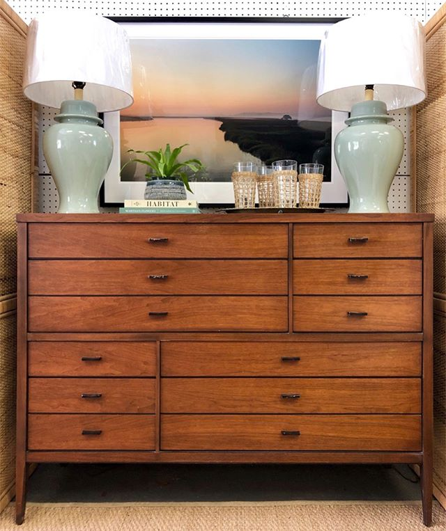 """For all you midcentury fanatics out there this is one truly special piece! Walnut Tuxedo Chest by Lane with rosewood butterfly joints (scroll to second pic). Eight drawers and in really good vintage condition. - $795 (56"""" W x 18"""" D x 42"""" H) • """"Lowcountry Sunrise"""" by Michael Nixon - $950 framed (43"""" x 32"""") or $400 unframed (36"""" x 24"""") • Celadon Ginger Jar Lamps - $120 pair (shades not included) . . . #mcm #mcmfurniture #midcenturymodern #midmod #midcentury #vintagefurniture #midcenturyfurniture #walnut #rosewood #lanefurniture #midmodstyle #homeinspo #charleston #shopindigomarket #lowcountry #lowcountryphotographer"""