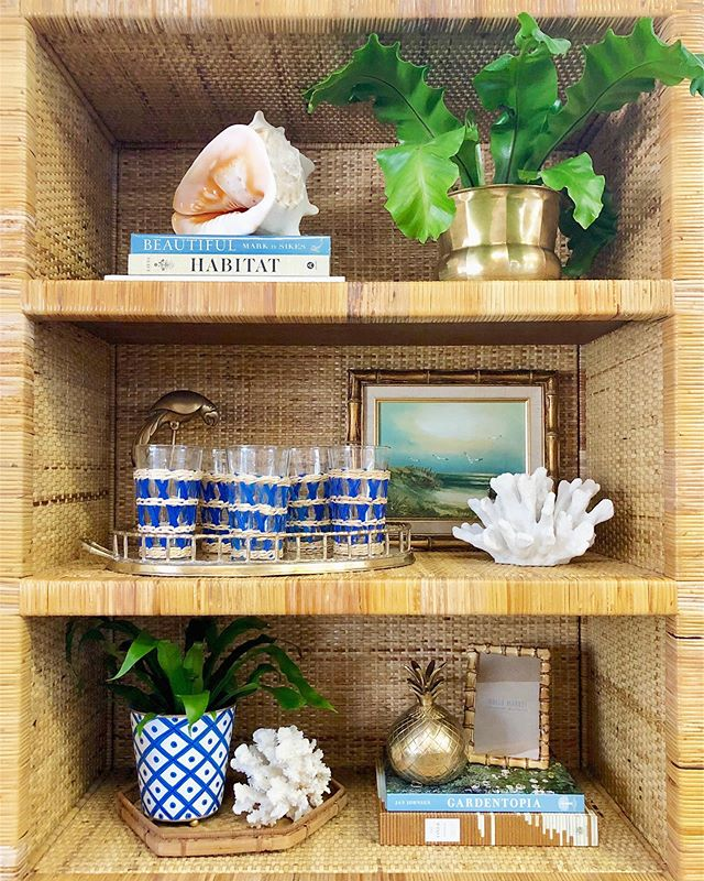 When it comes to styling we believe you have to love it to have it in your home. Ignore the rules, get what you love, and you'll make it work. Here are just a few things we love 💙 . . . #shelfie #shelfstyling #styling #homestyle #homestyling #homeinspo #coastalhome #coastalstyle #coastaldecor #islandstyle #blue #green #blueandgreen #coral #shell #art #barware #brass #bamboo #charleston