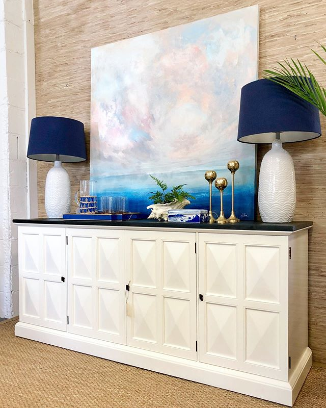 """Take a break from your Monday and step into this serene painting by Sarah Jeffers. Looks great above this vintage Henredon slate-top sideboard. • """"Before it Starts"""" acrylic on canvas - $750 (48"""" x 48"""") • Henredon Sideboard - $995 (71"""" W x 20"""" D x 31"""" H) • Blue & White Lamps - $250 pair . . . #lowcountry #lowcountryart #abstractart #charlestonscene #charleston #blueandwhite #blueandwhitehome #homeinspo #henredon #vintage #charlestonshopping"""