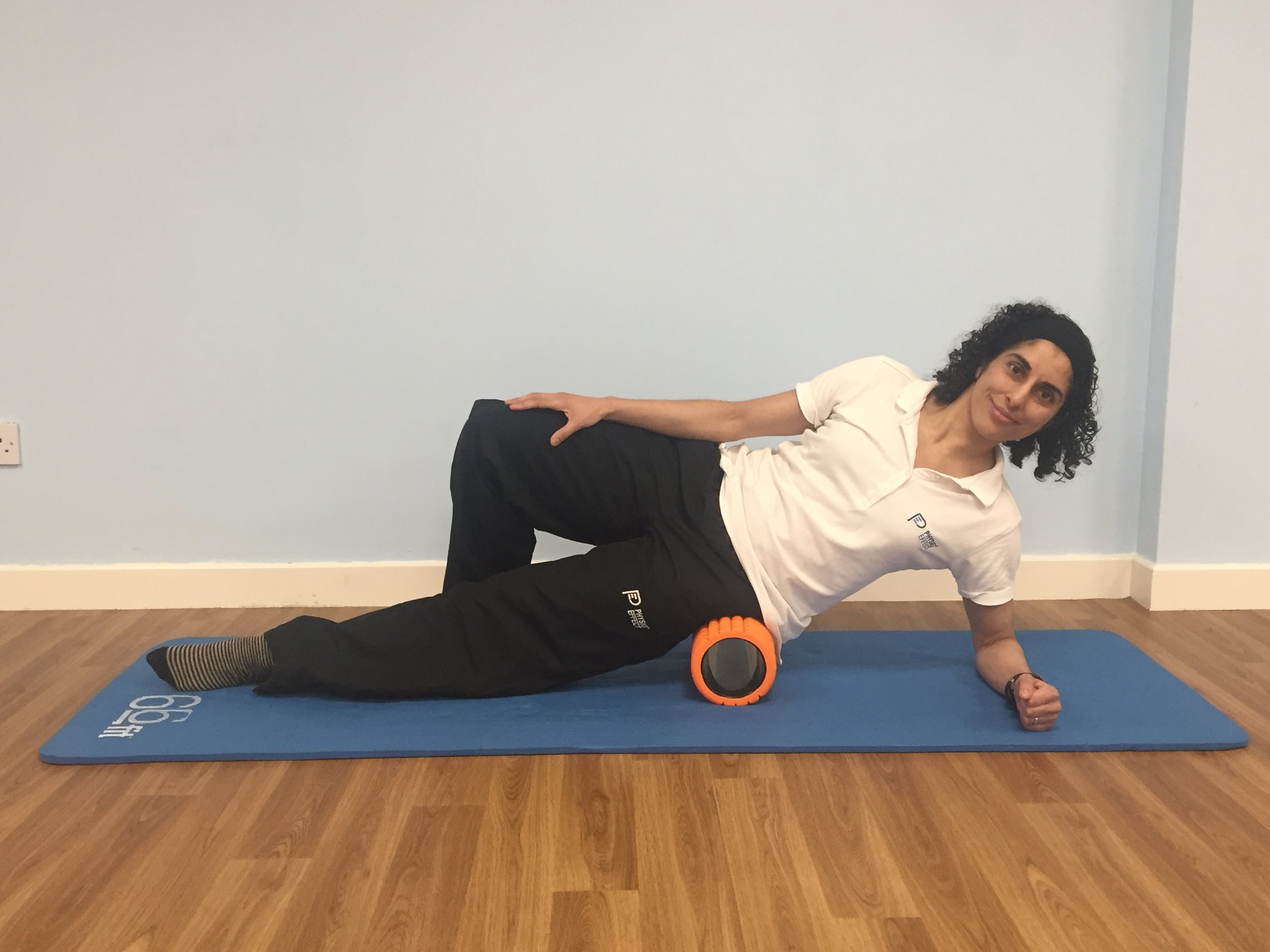 Foam rolling outer thigh