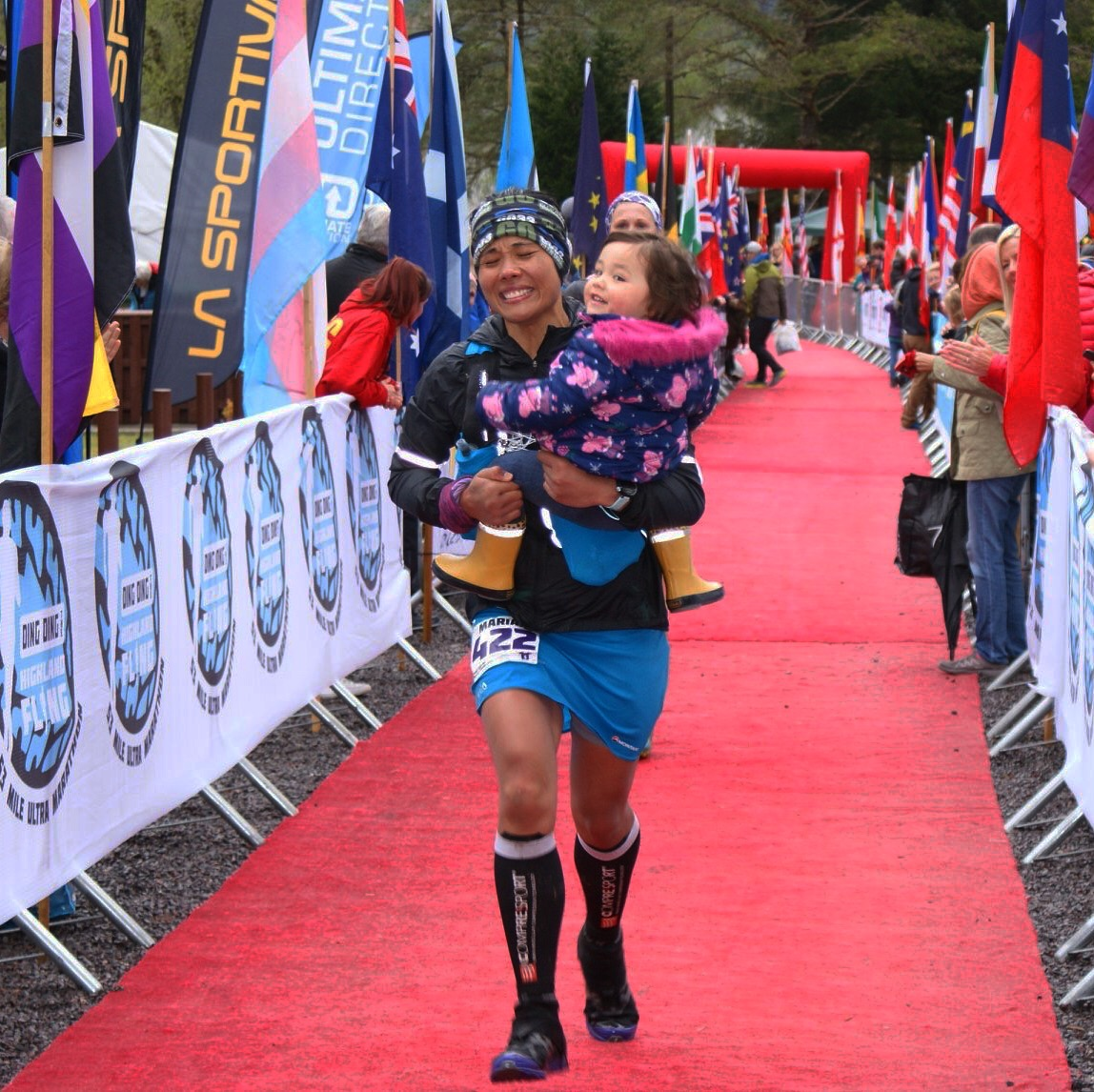 Carrying our daughter Aria along the red carpet to the Finish Line.