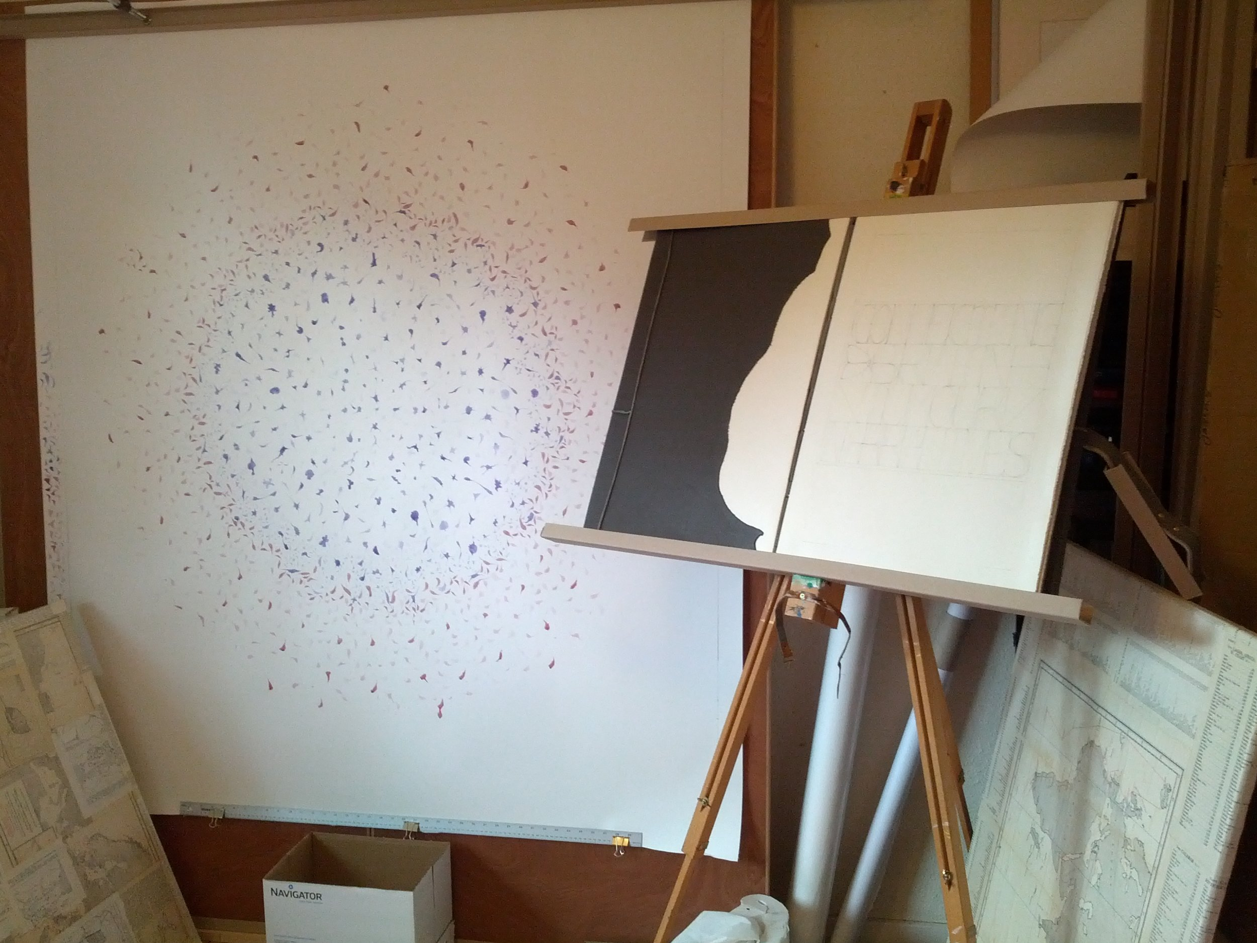 Image description; a giant ink drawing and the giant book in my studio