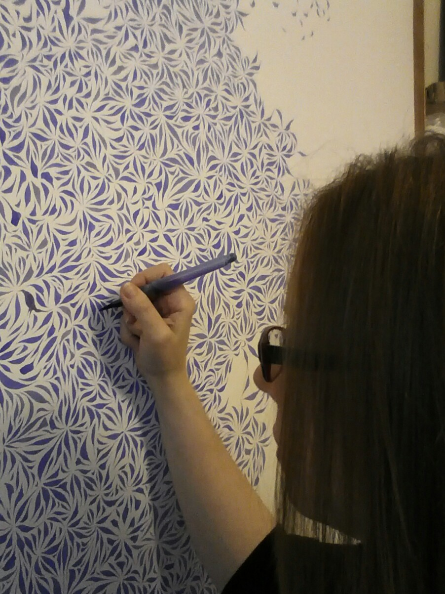 Image description; me apinting a giant ink pattern in purple ink.