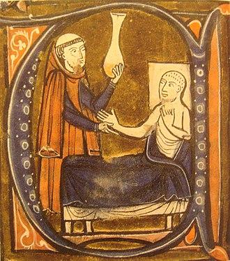"European depiction of the Persian (Iranian) doctor Al-Razi, in Gerardus Cremonensis ""Recueil des traités de médecine"" 1250-1260. A surgeon (left) holds the matula, a vessel for collecting the urine via Wikimedia"