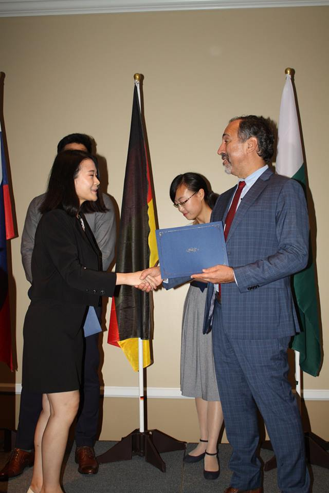 Melody receiving award from Dean of UFIC 2018.jpg