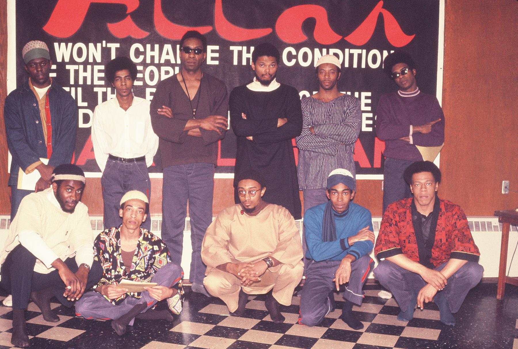 """Which brings me to July 2018 and publication of  Ballots and Bullets, Black Power Politics and Urban Guerrilla Warfare in 1968 Cleveland . Above a photo of Fred """"Ahmed"""" Evans on death row (tall, middle of photo, sunglasses). The Imam who performed Islamic services for prisoners, Mutawaf Shaheed, in white turtleneck next to Evans, became one of my main sources for information on the black nationalist movement in Cleveland in 1968."""