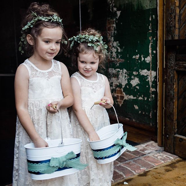 Flower girls scheming to steal the show with their cuteness in three, two, one..
