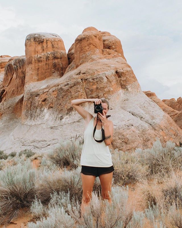 This shot was taken by @smokey_frazier from almost a year ago in Arches National Park. I was dripping sweat after a full day and a crazy camping trip in 105°. I promise I'll show up to your shoot better dressed than running shorts and a tank, but goodness do I love playing in nature with my camera and my hiking boots. I love that I can take my office anywhere!