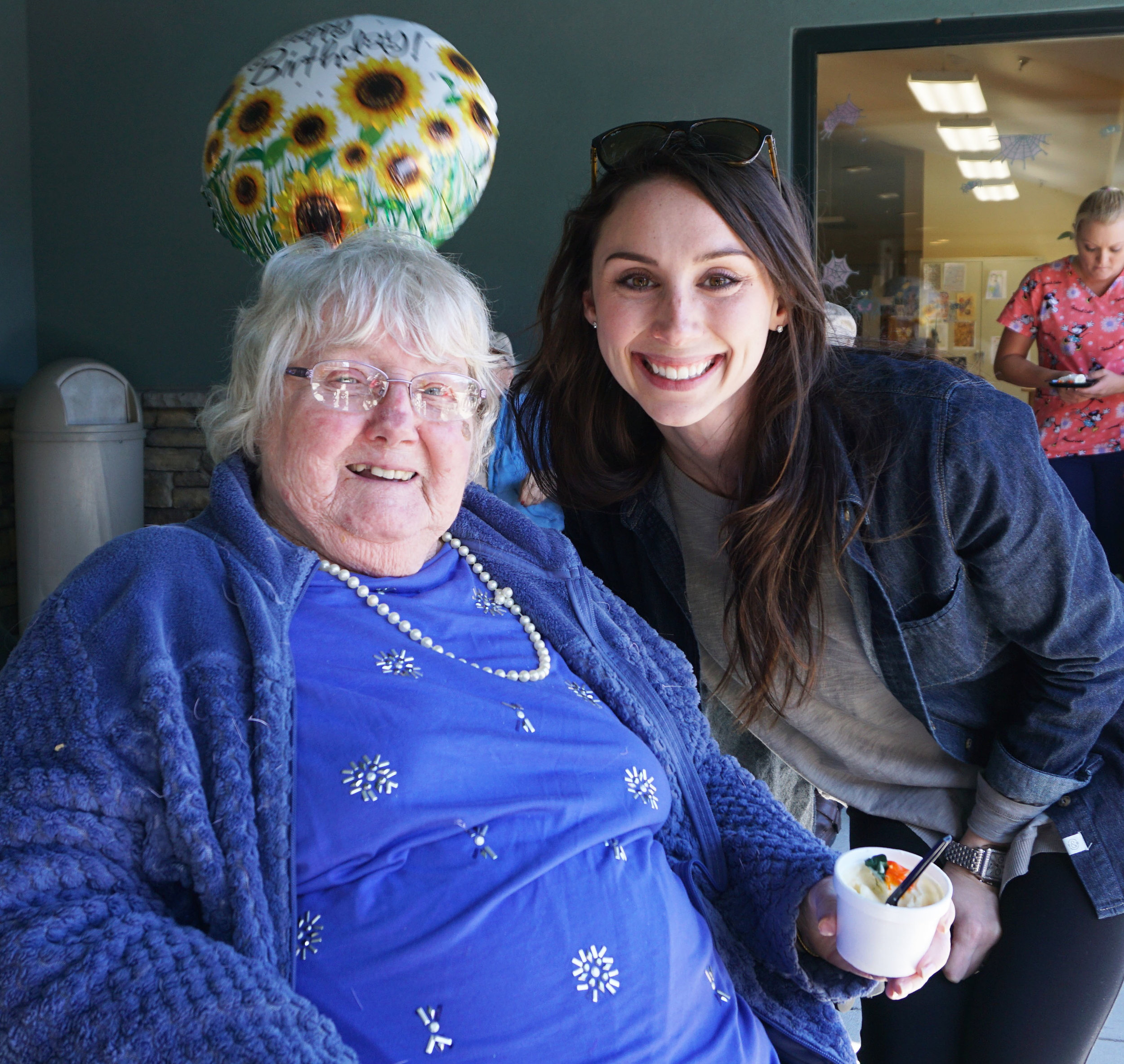 HAPPY DAY: Laura celebrated her birthday with a party of friends and staff, including Aubree Olmstead, Columbia Basin Care's executive director.