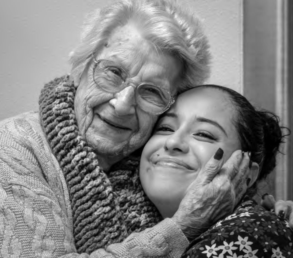 Veronica Quintero, certified nursing assistant, is embraced by Eva Phelps, a resident at Columbia Basin Care. Veronica has been named Oregon Caregiver of the Year.