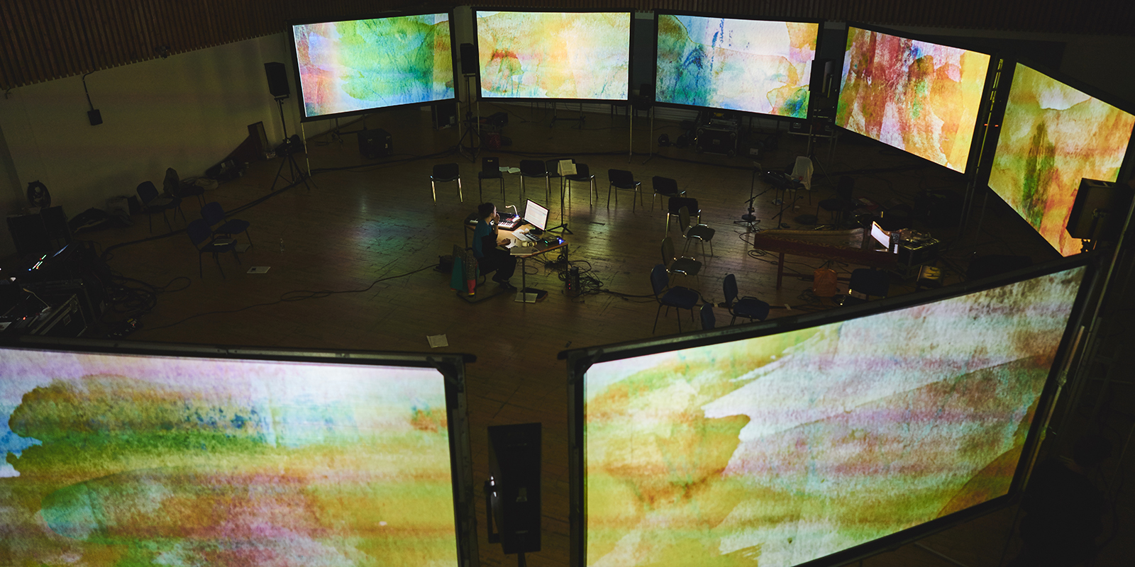 MICROSITE BANNER Circle of screens during rehearsals.jpg