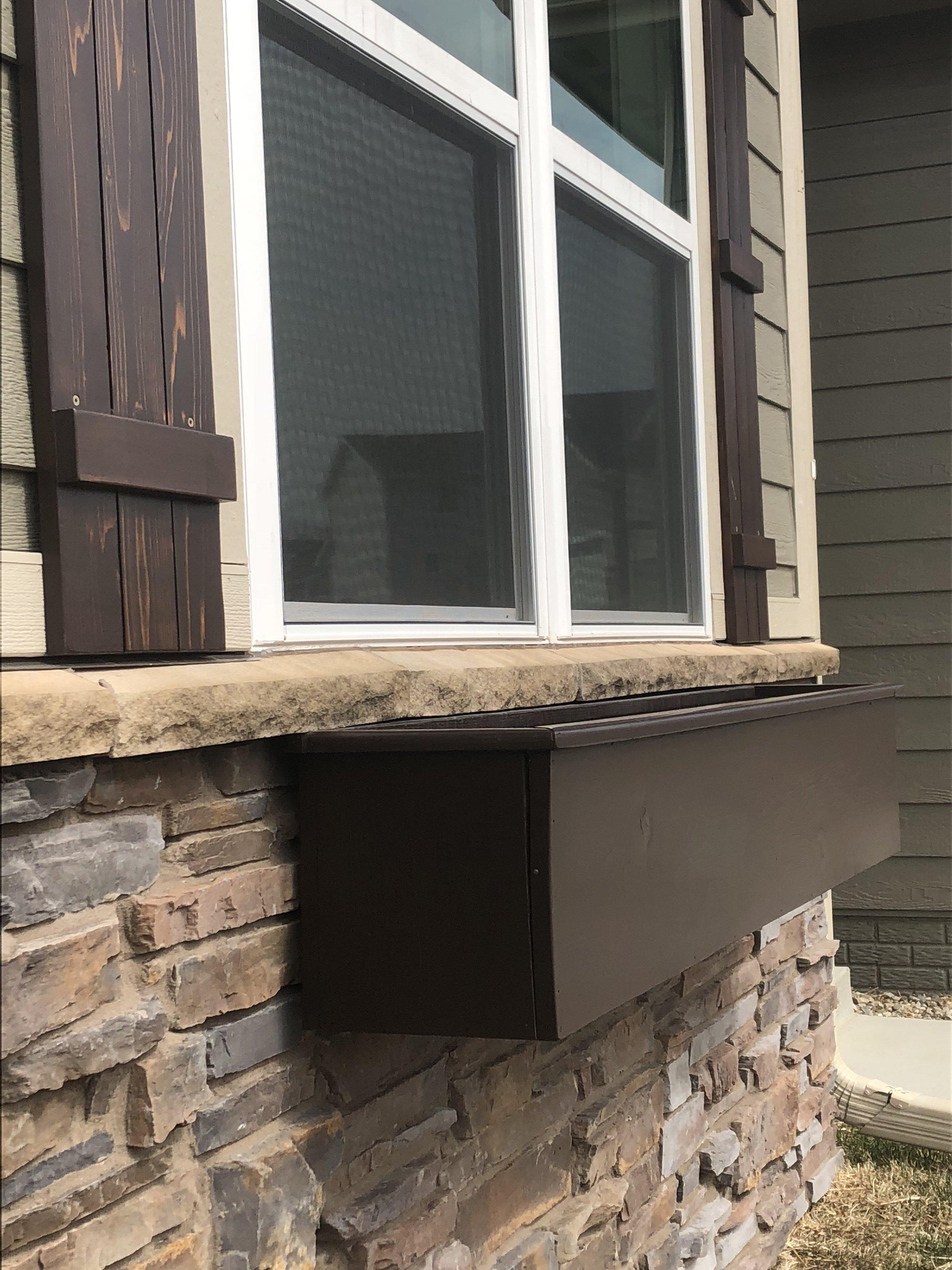 cedar shutters with planter box.jpeg