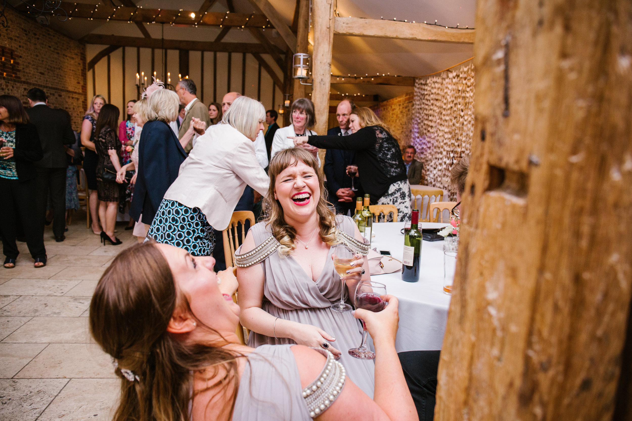 fun photo of bridesmaids laughing together at a diy wedding at upwaltham barns