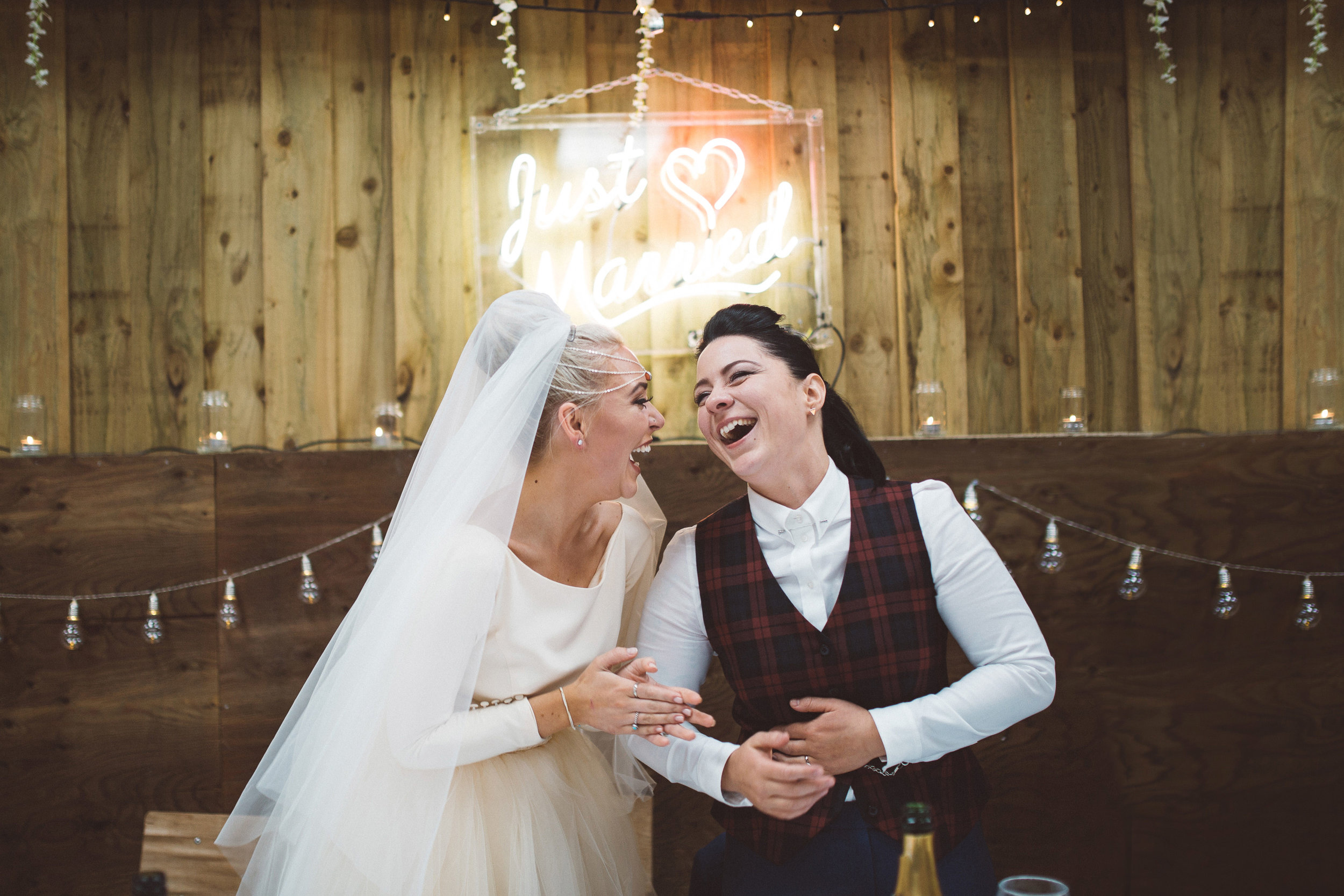 lucy spraggan and her wife laughing during their wedding speeches
