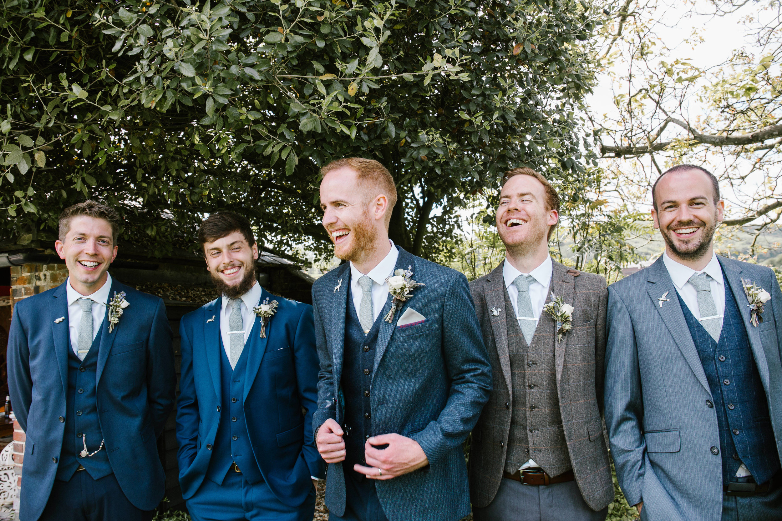groom and his groomsmen looking extra dapper in the gardens of upwaltham barns chichester